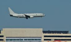 Boeing P-8 with original MAC plant behind.