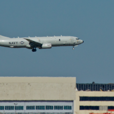 Boeing P-8 with original MAC plant behind.